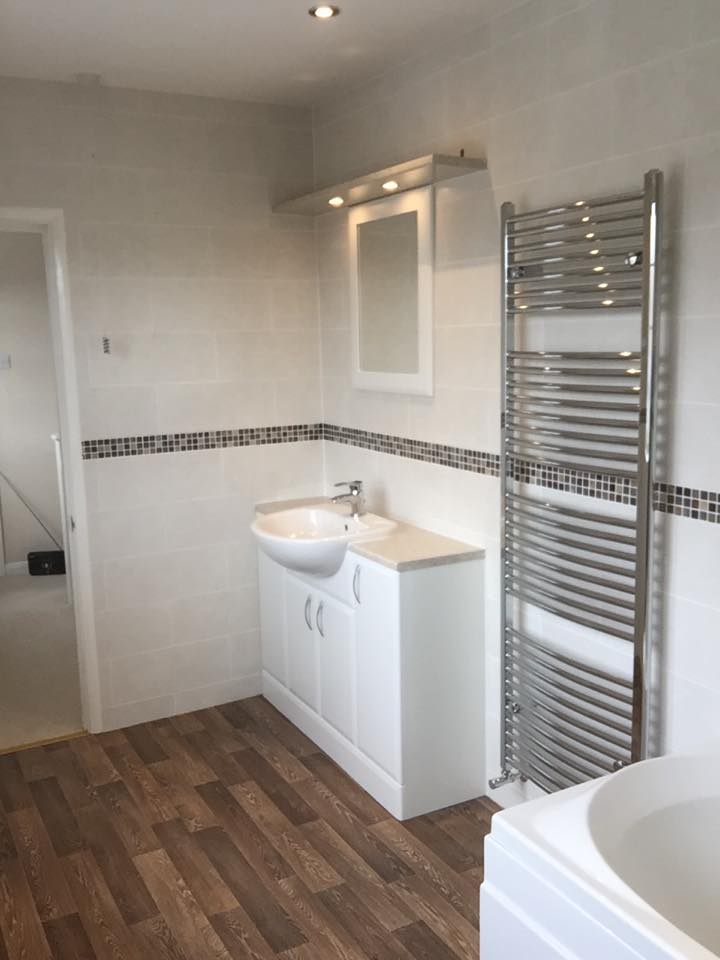 Bathroom Fitted in Milton Keynes with wooden floor - angled at sink