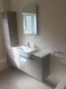 luton bathroom fitted with wooden cabinets