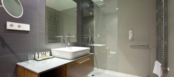 modern bathroom design with large grey tiles